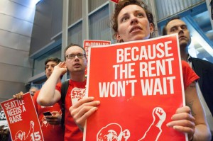 Activist gather at Seattle City Hall during the campaign to raise the city's minimum wage. Photo Credit: David Ryder/Reuters